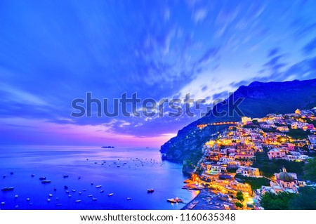 View of Positano village along Amalfi Coast in Italy at dusk. #1160635348