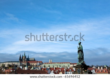 View of Prague city skyline viewed over Vlatava river with Prague Castle and Saint Vitus Cathedral