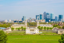 View of Queens House and Canary Wharf from Greenwich Park in London, England, UK