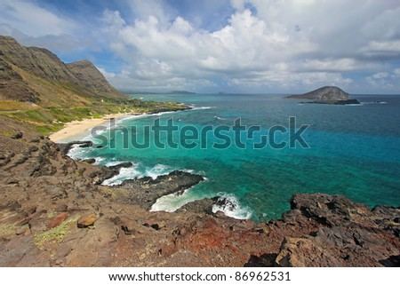 View of Rabbit Island and Makapu'u Beach Park from Makapu'u Point near Honolulu on the southeast coast of the Hawaiian island of Oahu