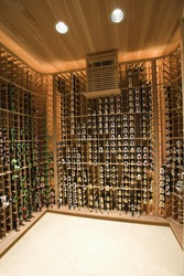 View of racks with wine bottles at domestic wine cellar