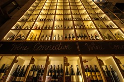 View of racks with wine bottles at wine cellar