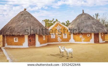 View Of Rajasthan Village Near Thar Desert Jaisalmer With Mud Huts Painted Walls 1052422646
