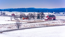 View of red barns and snow-covered farm fields from Longstreet Tower in Gettysburg, Pennsylvania.