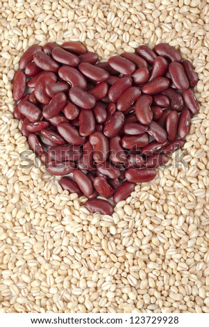 View of red kidney beans forming heart shape surrounded with wheat.