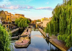 View of Regent's Canal and Camden Town in London, England, at sunset; blue sky in the background