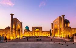 View of Registan square in Samarkand - the main square with Ulugbek madrasah, Sherdor madrasah and Tillya-Kari madrasah at sunset. Uzbekistan
