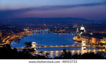 View of river Danube and Chain Bridge in Budapest shot during magic hour just after sunset.