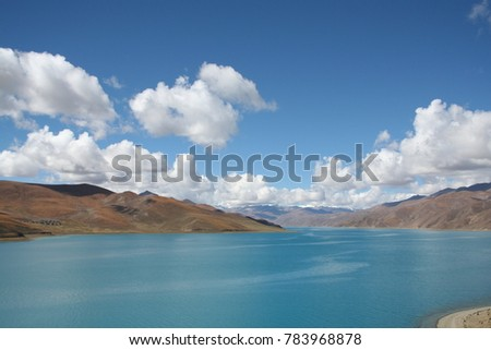view of river with hills, blue sky and clouds in the background #783968878
