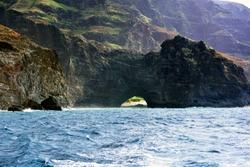 View of rock arch on the Na Pali Coast Kauai Hawaii