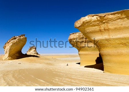 View of rocks and dunes in Sahara desert