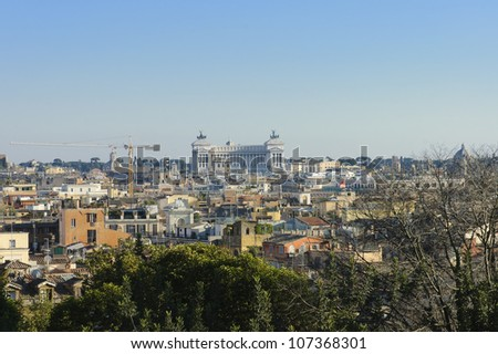 view of Rome  from Pincio hill at sunset with the war memorials monument on the background., Italy