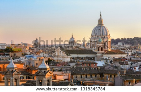View of Rome from the Pincho hill. Panorama of the city center at sunset. Tiled roofs of houses, the dome of St. Peter. Sunset. #1318345784