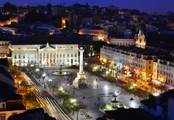 View of Rossio Square at night and Maria II Theatre, seen from Santa Just elevador. Lisbon, Portugal
