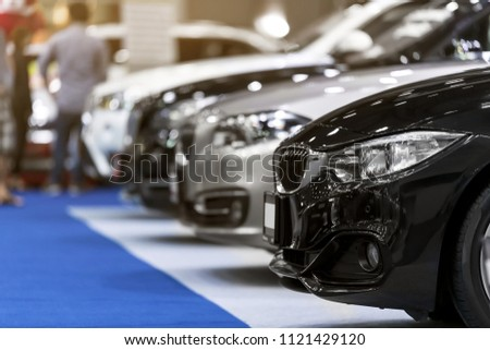 View of row new cars at showroom.