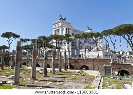 View of ruins of ancient Rome and Monument of Vittorio Emanuele - stock photo
