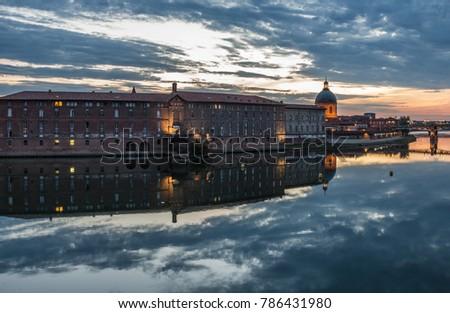 view of Saint-Pierre bridge over Garonne river and Dome de la Grave in Toulouse at majestic sunset