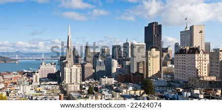 View of San Francisco downtown and financial district, with the Bay Bridge in the background.