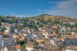 View of San Nicolas church and Sacromonte hill in Granada, Spain