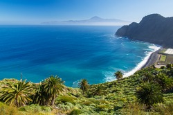 View of Santa Catalina beach and mountains with Tenerife island in the background, La Gomera island