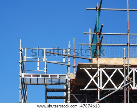 View of scaffolding tower against blue cloudless sky