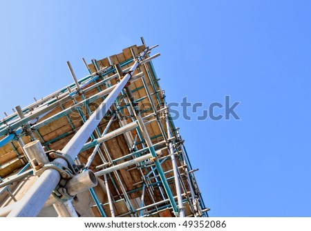 View of scaffolding tower against cloudless blue sky