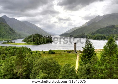 View of Scottish Highland from Glenfinnan with war monument and lakes surrounded by mountains HDR