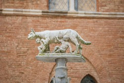 View of She-wolf of Siena (Lupa Senese) with Senio and Ascanio, sons of Remo, founders of the city. Marble statue, symbol of the city of Siena