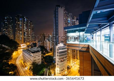 View of skyscrapers and Pok Fu Lam Road at night, from Hong Kong University, in Hong Kong, Hong Kong.