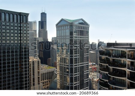 View of skyscrapers in downtown Chicago with Sears Tower in the background.