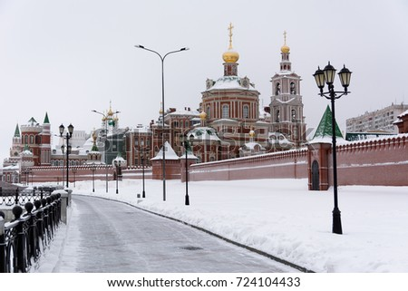 Shutterstock View of snow-covered houses of red brick on the embankment of the city of Yoshkar-Ola, Russia