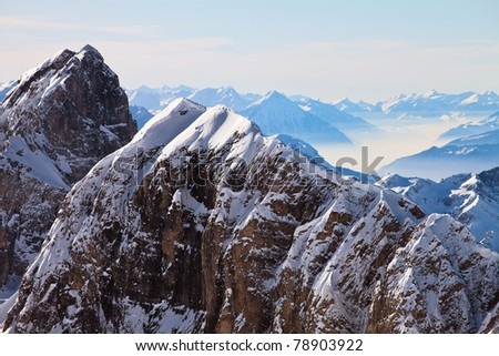 View of snow covered mountain range in the Swiss Alps. Mount Titlis, Engelberg, Switzerland. - stock photo
