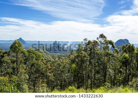 View of some mountains of the Glass House Mountains National Park, from left to right Mount Beerwah, Mount Coonowrin, Mount Tibberoowuccum and Mount Tibrogargan #1433222630