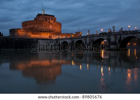 View of St. Angel Castle from Tiber river in Rome at dawn