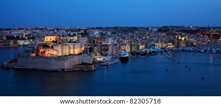 View of St. Angelo Fort and Dockyard Creek in  night. Malta