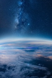 View of stars and milkyway above Earth from space