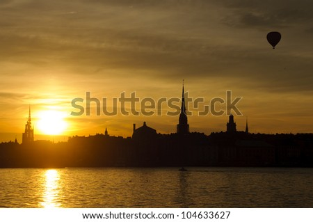 View of Stockholm old town (Gamla stan) and harbor at sunset