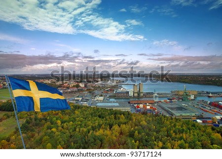 View of Stockholm seaport with flag. Sweden.