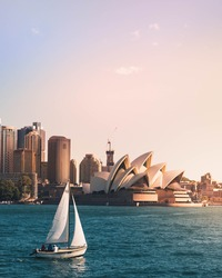 View of Sydney Opera House with sailboat