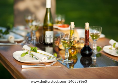 View of table setting in lawn