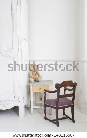View of teddy bear on child's study table by wardrobe
