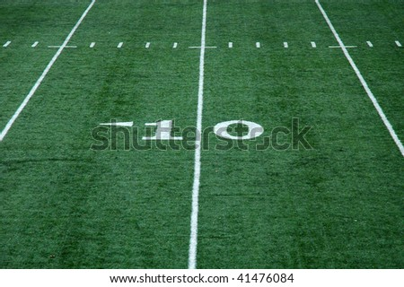View of ten yard line on an artificial turf football field - stock photo