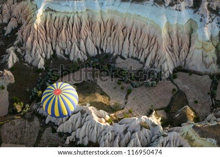 View of the air balloon flying over rock formation