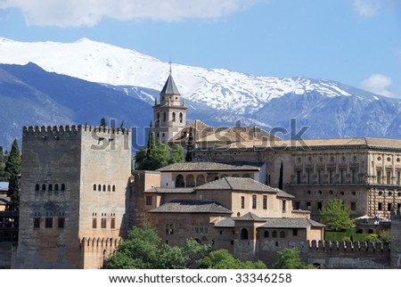 View of the Alhambra palace in the late afternoon with the Sierra Nevada mountains in the background.This is an UNESCO World Heritage site.