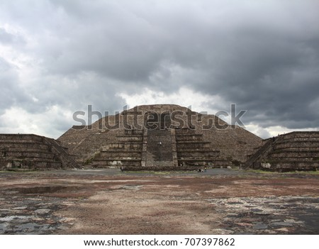 View of the ancient city of Teotihuacan on a cloudy day. Pyramid of the Moon at the back. Mexico. #707397862