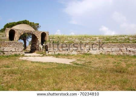 View of the ancient greek amphitheatre at Paestum, Campania, Italy.