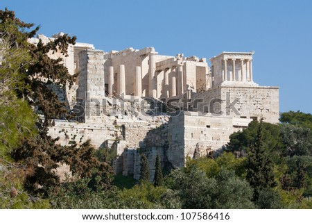 View of the ancient ruins of the Propylaia and the Temple of Athena Nike on the Acropolis of Athens, Greece.