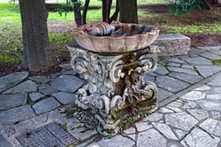 View of the ancient street fountain near the Fortress of Bergamo (Rocca di Bergamo in Italian). Italy.