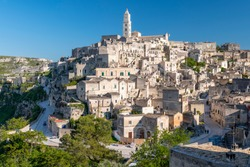 View of the ancient town and historical center called Sassi, perched on rocks on top of hill, Matera, Basilicata, Italy.