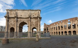 View of the Arch of Constantine with the Colosseum in the background.